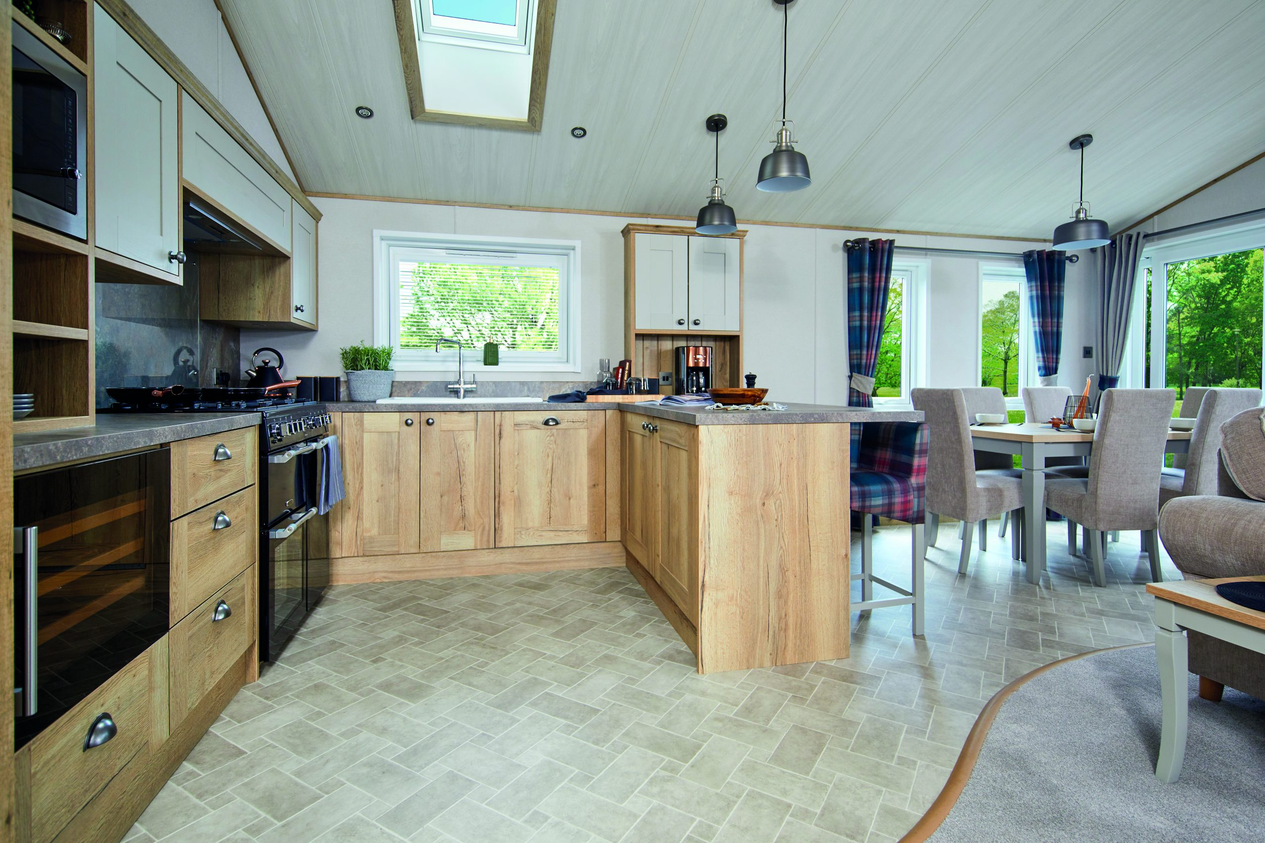 open plan living room and kitchen in wooden lodge