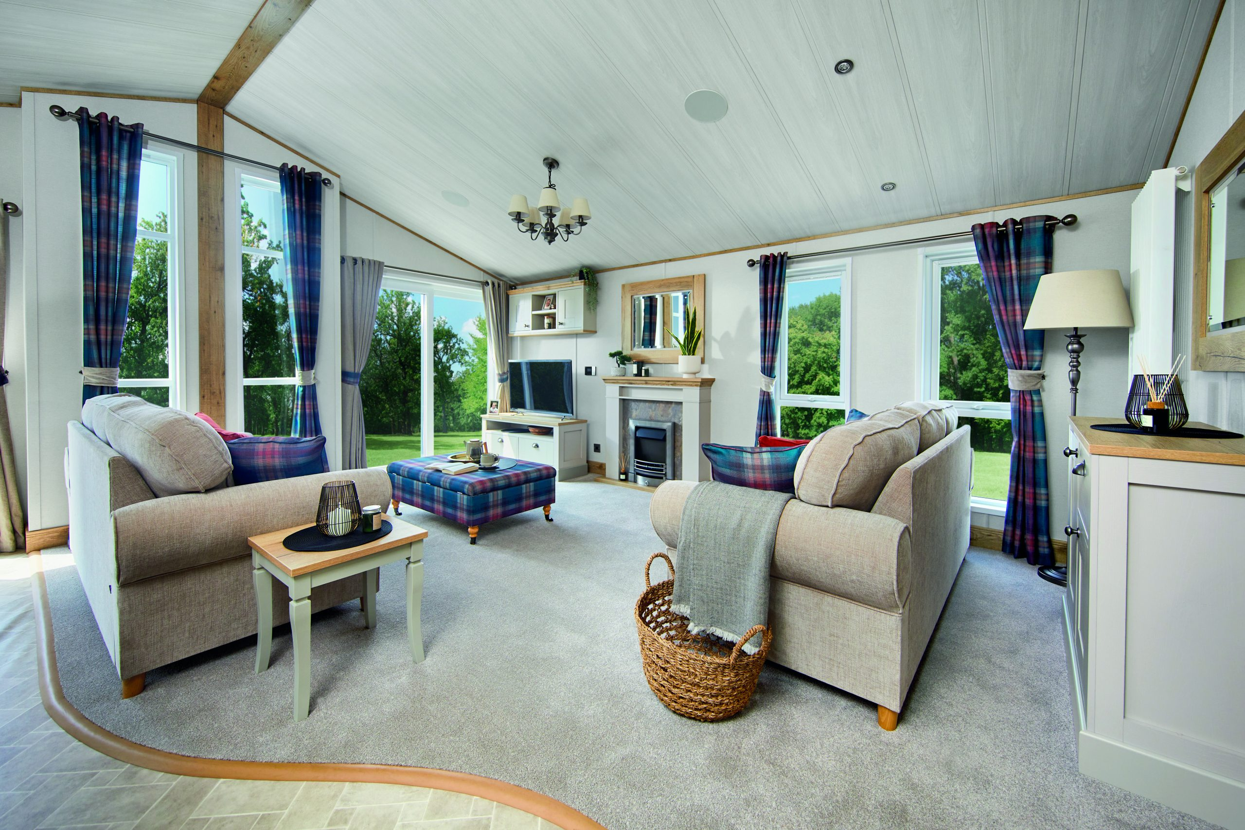 wooden lodge living room with sofas and tv